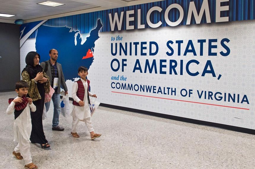 International travellers leave the Customs and Immigration area of Dulles International Airport on June 29, 2017, outside Washington, DC, in Dulles, Virginia.