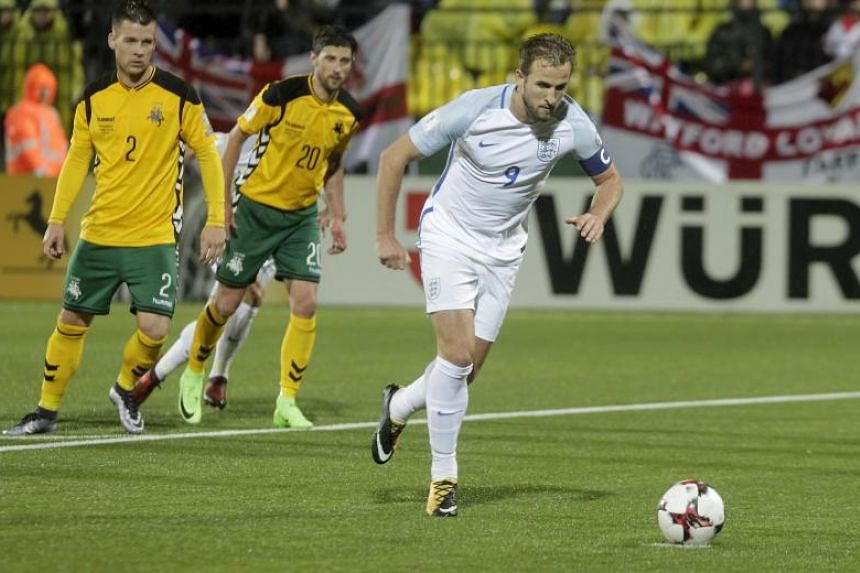 Harry Kane (right) of England scores by penalty during the FIFA World Cup 2018 qualification soccer match on Oct 8, 2017