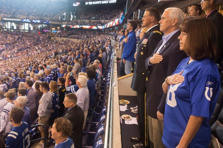 US Vice President Mike Pence (second right) and his wife Karen Pence (right) stand during the US national anthem before the San Francisco 49ers at Indianapolis Colts NFL game on Oct 8, 2017.