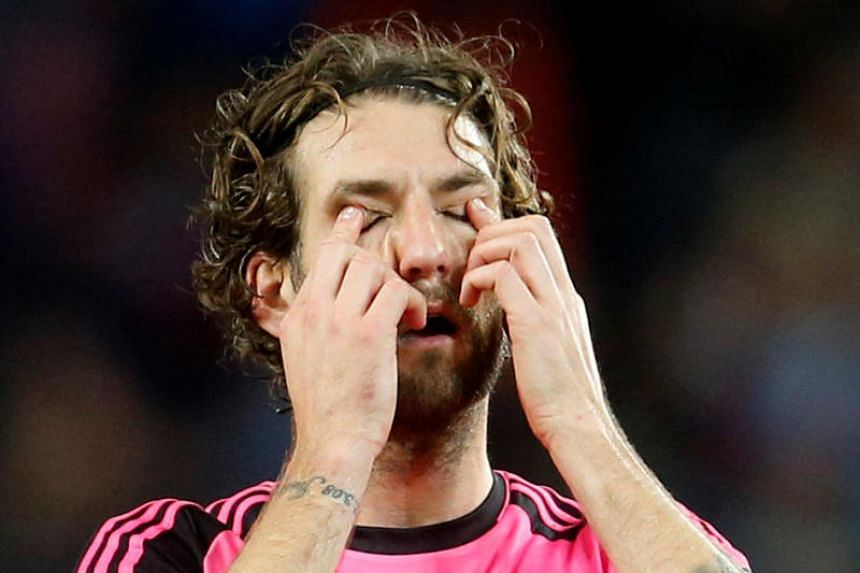 Scotland's Charlie Mulgrew looks dejected after his side was eliminated from World Cup 2018.