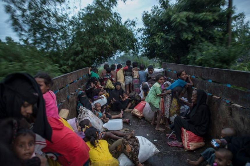 Rohingya Muslim refugees are evacuated in a truck to a refugee camps after crossing the Naf River, in Teknaf, Bangladesh's Ukhia district on Oct 8, 2017.