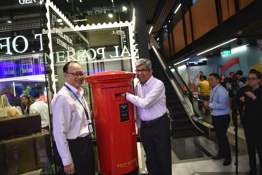 Minister for Communications and Information Yaacob Ibrahim (right) at the official launch of the redeveloped SingPost Centre in Paya Lebar on Monday, Oct 9, 2017.