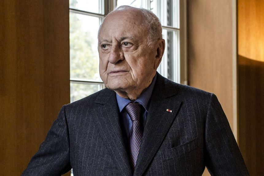 Madison Cox is the presumptive legal heir to the estate of businessman Pierre Berge (above), who was the brain behind designer Yves Saint Laurent's fashion empire.