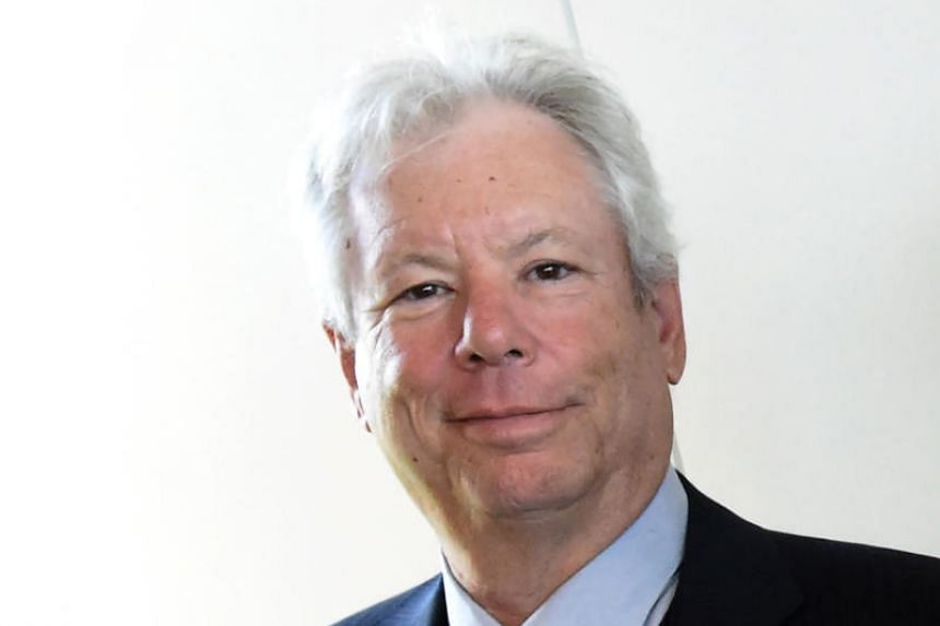 Picture taken on June 22, 2014 shows US economist Richard Thaler after he was awarded the 2014 Global Economy Prize during the award ceremony in Kiel, northern Germany.