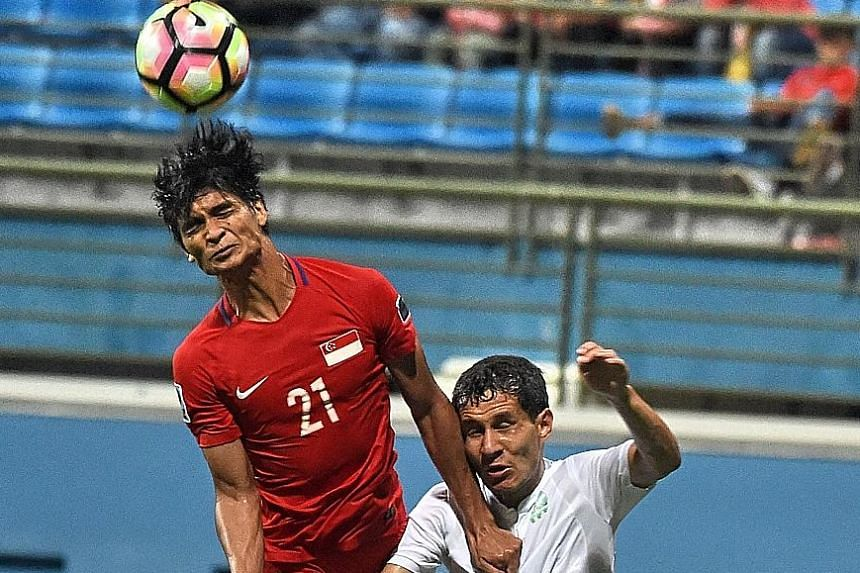 Singapore's Safuwan Baharudin getting the better of Turkmenistan's Gurbangeldi Batyrov in their Asian Cup qualifier at Jalan Besar Stadium last month. While the Lions have yet to win playing their new 3-4-3 formation, they have shown promise - scorin