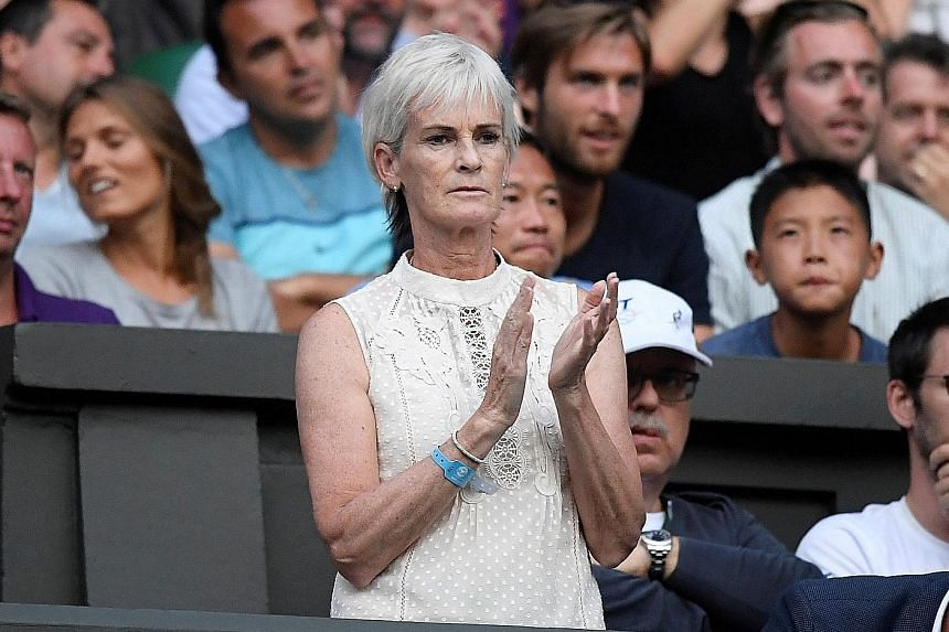 Three-time Grand Slam champion Andy Murray's mother Judy applauding him during Wimbledon this year. She feels that there are not many recognisable women players beyond the Williams sisters and Maria Sharapova.