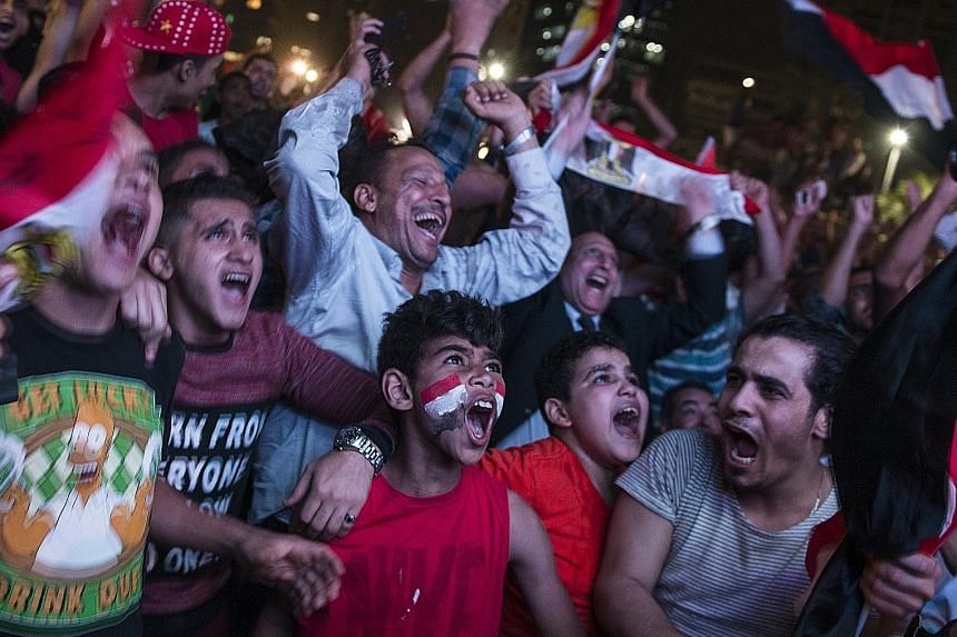 Above: Egypt fans spilling out onto the streets of Cairo after the full-time whistle was blown, following Salah's 95th-minute penalty winner against Congo.