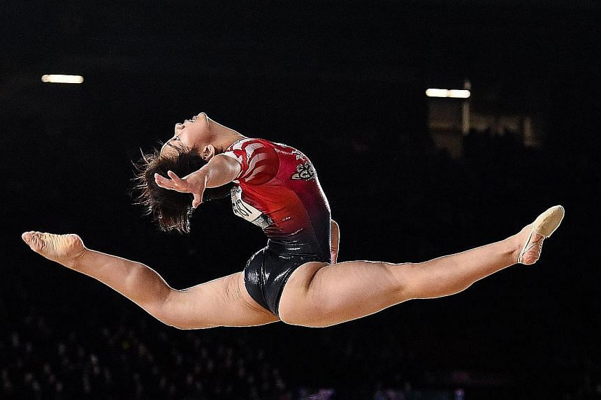 Mai Murakami leaping high during her floor exercise routine at the Artistic Gymnastics World Championships in Montreal. After finishing only fourth in the individual all-around final, she won the gold in the floor exercise, and became the first Japan
