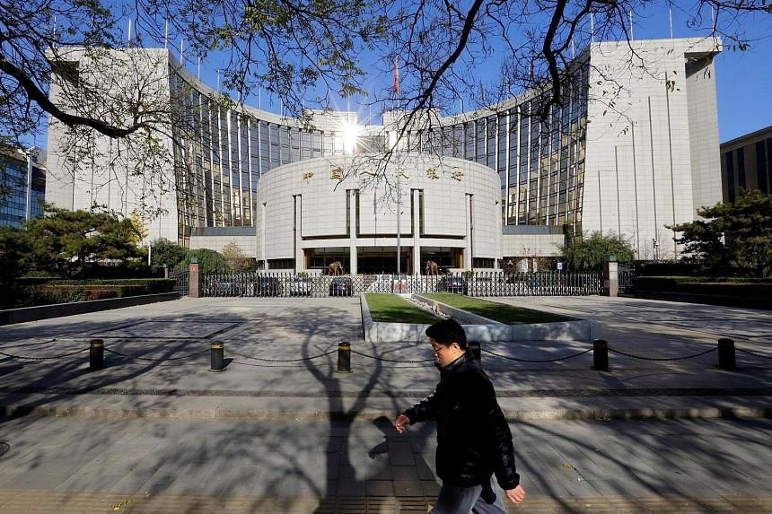 The People's Bank of China headquarters in Beijing. How the central bank sets policy in response to economic data may potentially be recalibrated after the upcoming Chinese Communist Party transition, says Mr M. K. Tang, senior China economist at Go