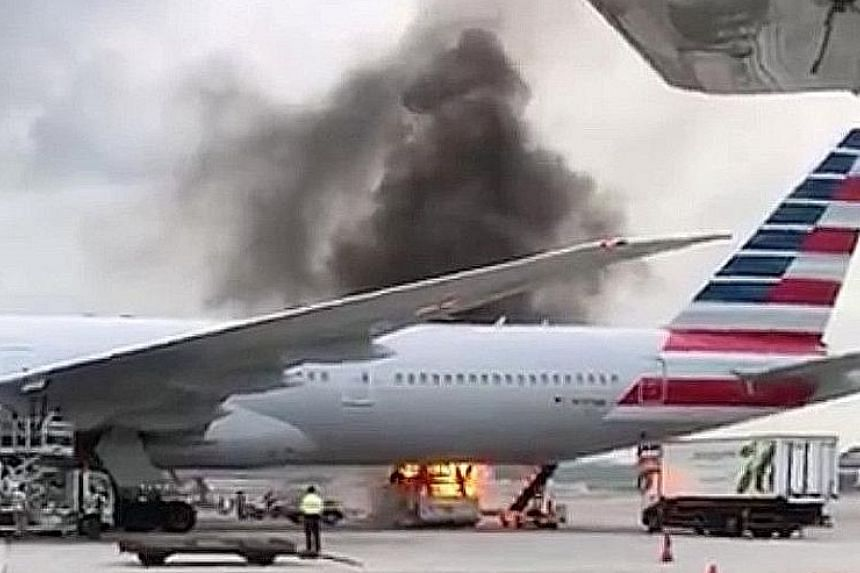 A fire broke out on the tarmac of Hong Kong International Airport yesterday, with black smoke seen billowing near the belly of an American Airlines plane. The blaze began at around 5.30pm in one of the parking berths and one person was injured, polic