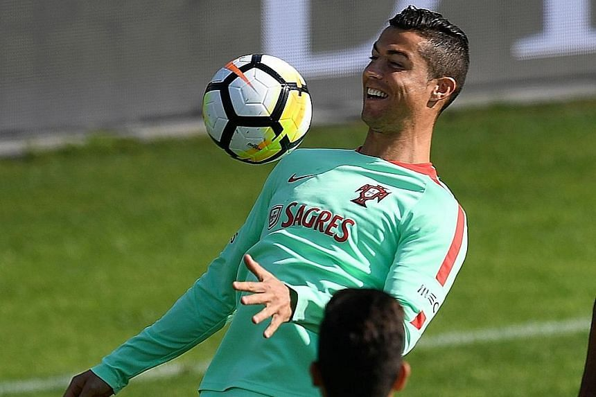 Portugal captain Cristiano Ronaldo is all smiles in training ahead of today's final qualifying home match against Group B leaders Switzerland. Only a win will do for the European champions.