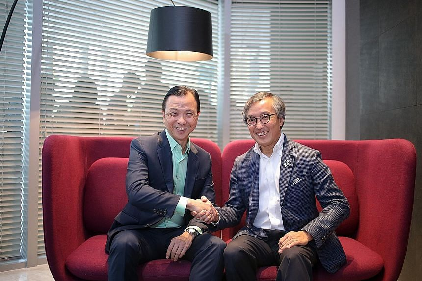 StarHub chief executive Tan Tong Hai (left) with OCBC chief operating officer Ching Wei Hong. The firms believe collaboration between different industries is a way to beat the competition. OCBC's orchardgateway branch combines its financial services