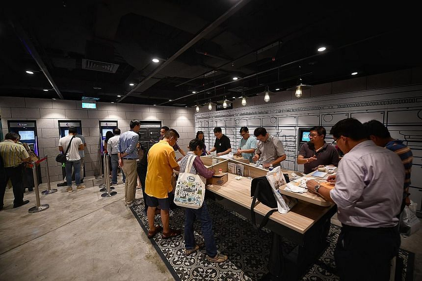 The self-service area of the General Post Office in the redeveloped SingPost Centre in Paya Lebar, which was officially launched yesterday. The self-service area is accessible at all hours and has POPStation lockers, upgraded SAM machines and a self-