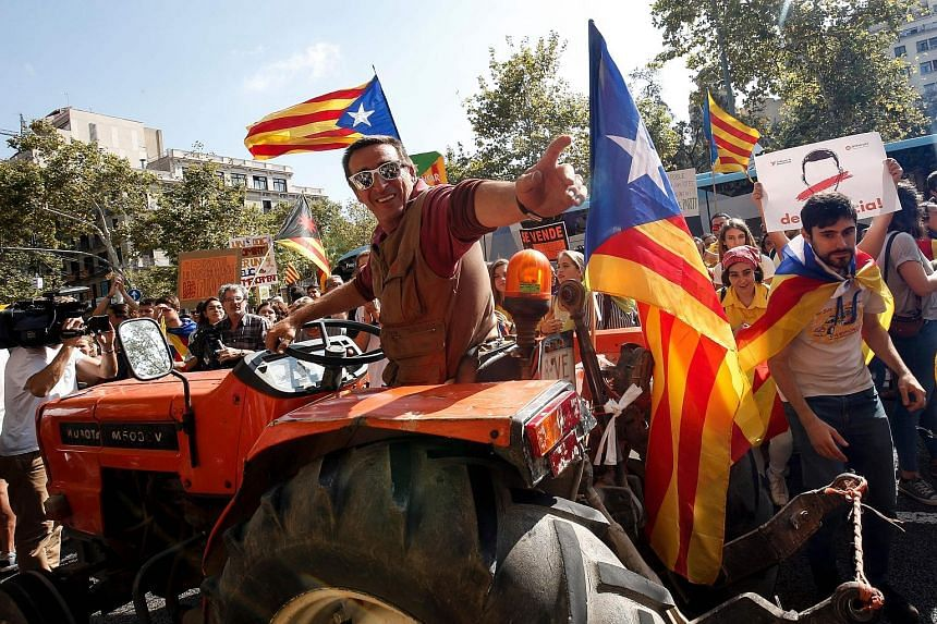 Farmers in Catalonia have lent their strength to independence marches, riding with the demonstrators, parking their tractors outside polling stations as a line of defence against intervention by the Spanish police.