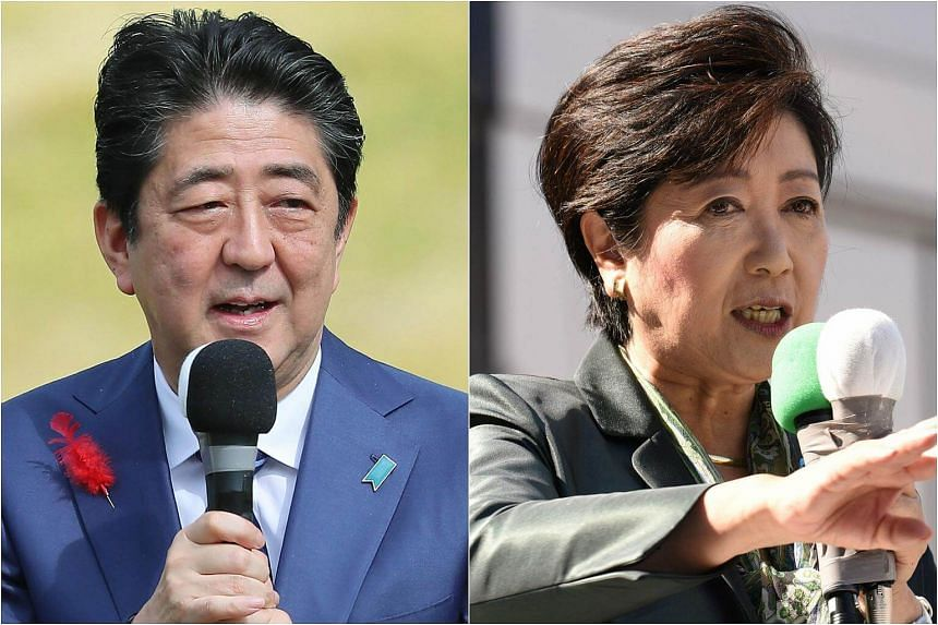 Japan's Prime Minister Shinzo Abe (left) delivering a speech at an election campaign appearance in Fukushima, and Tokyo Governor Yuriko Koike giving her speech at a train station during an election campaign appearance in Tokyo, on Oct 10, 2017.