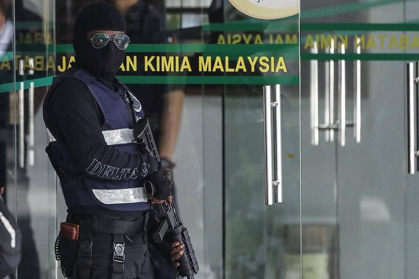 A Royal Malaysia Police officer stands guard at the Malaysia Chemistry Department in Petaling Jaya, Malaysia, on Oct 9, 2017.