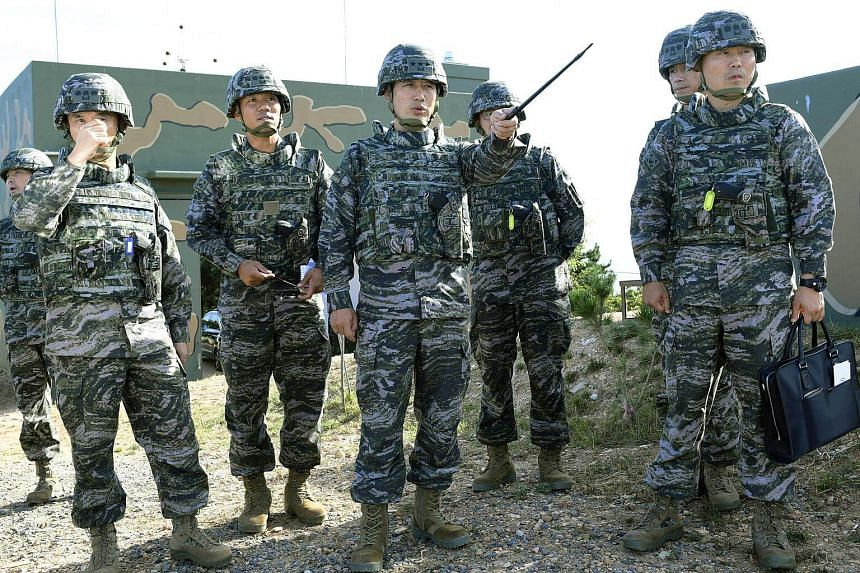Marine Corps commander Jun Jin Goo (centre) inspecting troops on the Yeonpyeong Island near the tense maritime border with North Korea, in Yeonpyeong, South Korea, on Oct 7, 2017.