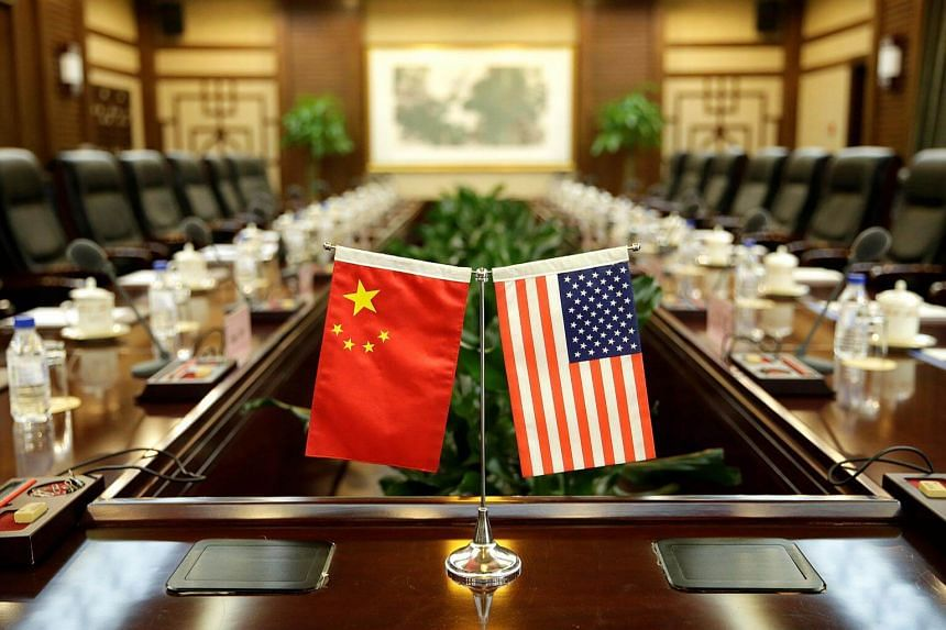 Flags of US and China are placed for a meeting in Beijing, on June 30, 2017.