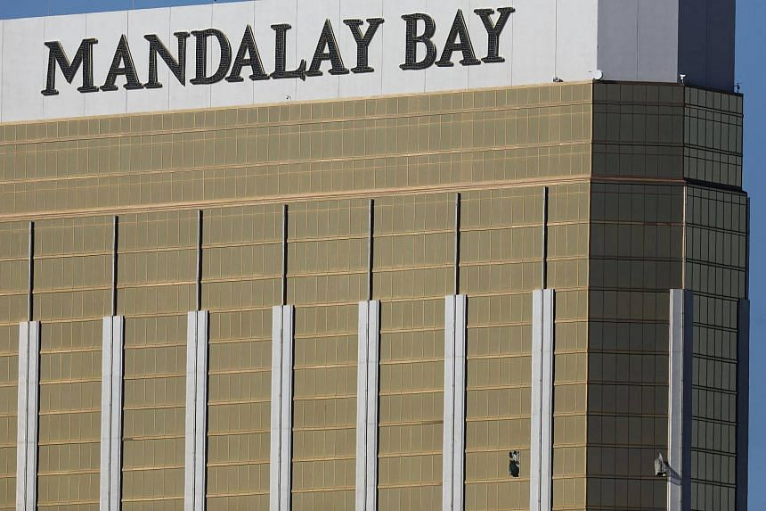 A window is broken on the 32nd floor of the Mandalay Bay Resort and Casino where a gunman opened fire on a concert crowd on the night of Oct 3, 2017 in Las Vegas, Nevada.