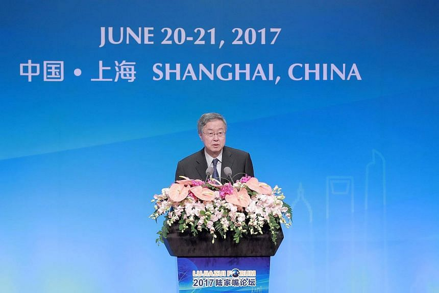China's central bank governor Zhou Xiaochuan delivers a speech during the annual Lujiazui Forum in Shanghai, on June 20, 2017.