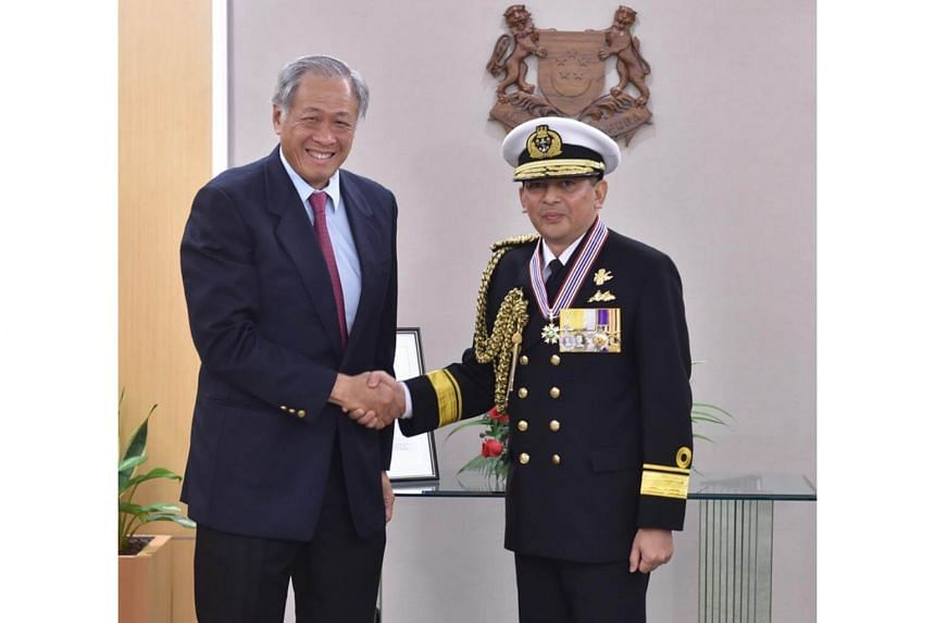 Minister for Defence Dr Ng Eng Hen congratulating Commander of the Royal Brunei Navy, First Admiral (FADM) Pengiran Dato Seri Pahlawan Norazmi bin Pengiran Haji Muhammad, after the Meritorious Service Medal (military) investiture at the Ministry of D