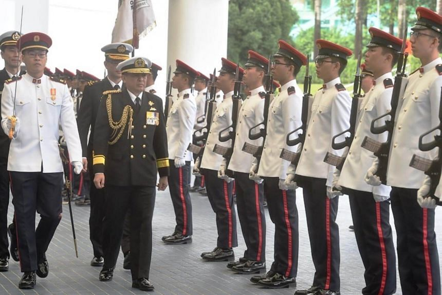 FADM Dato Norazmi inspecting the Guard of Honour at MINDEF.