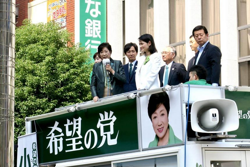 Tokyo Governor Yuriko Koike speaks at a morning rally for party candidate Kaoru Matsuzawa, a lawyer, in the upmarket district of Azabujubann on Oct 10.