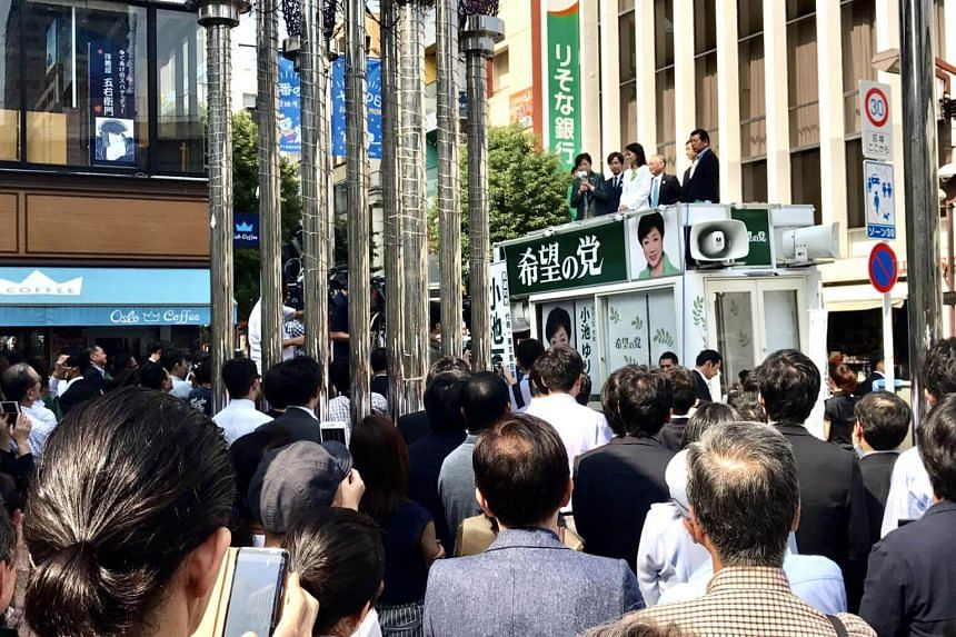 A crowd gathers in front of the Azabujuban shopping street to listen to Tokyo Governor Yuriko Koike stump for party candidate Kaoru Matsuzawa, a lawyer, in the upmarket district of Azabujuban, on Oct 10.
