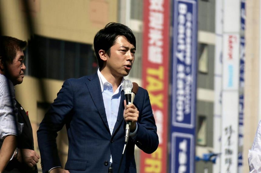 Political blue blood Shinjiro Koizumi of the ruling Liberal Democratic Party (LDP) - son of former prime minister Junichiro Koizumi, addresses a lunchtime rally at a busy traffic intersection in Ikebukuro on Oct 10 afternoon.