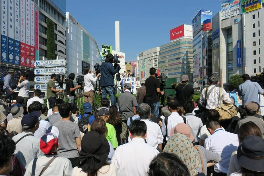 Part of the crowd which turned up to listen to LDP lawmaker Shinjiro Koizumi and candidate Hayato Suzuki, 40, an incumbent one-term Lower House lawmaker, speak at a busy traffic intersection in Ikebukuro on on Oct 10.