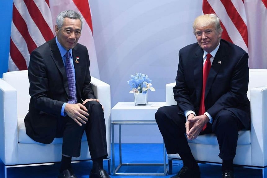 US President Donald Trump and Singapore's Prime Minister Lee Hsien Loong hold a meeting on the sidelines of the G20 Summit in Hamburg, Germany, on July 8, 2017.