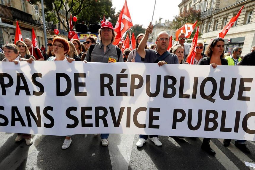 Public sector workers hold a banner during a demonstration as part of a nationwide strike against French government reforms in Bordeaux, France, on Oct 10, 2017.