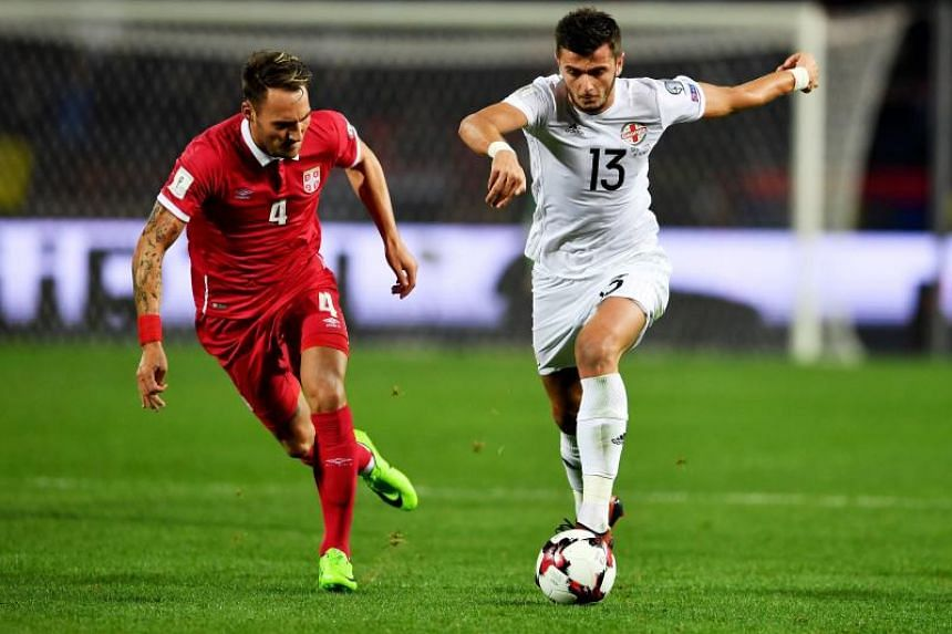 Georgia's Georgi Kvilitaia (right) vies with Serbia's Nemanja Gudelj during the Fifa World Cup 2018 qualification football match between Serbia and Georgia at the Rajko Mitic stadium in Belgrade on Oct 9, 2017.
