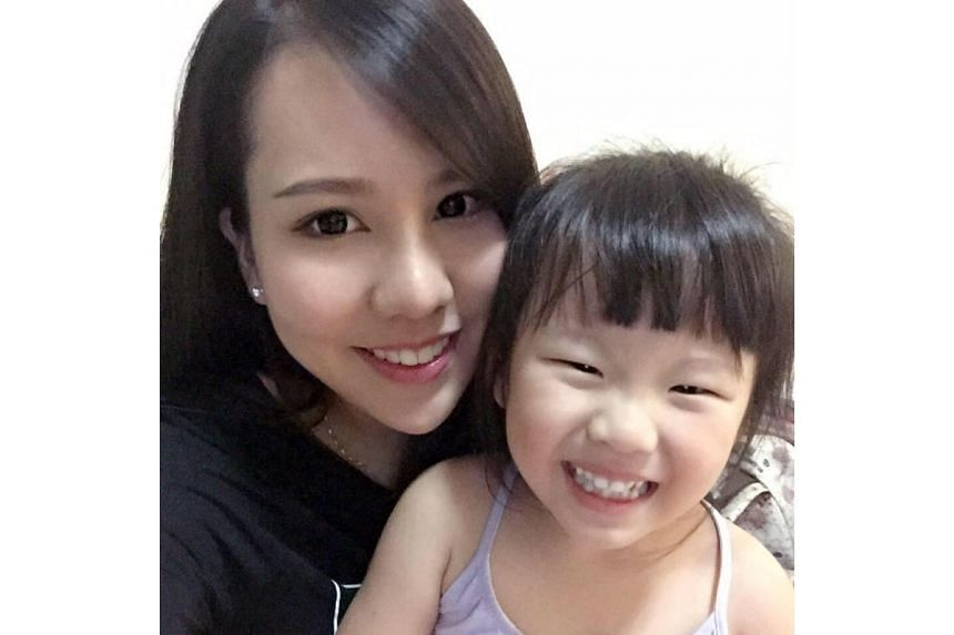 Ms Jacelyn Wong, 24, with her daughter Eleanor Tan, four, who died in an accident in Bukit Batok on Monday (Oct 9).