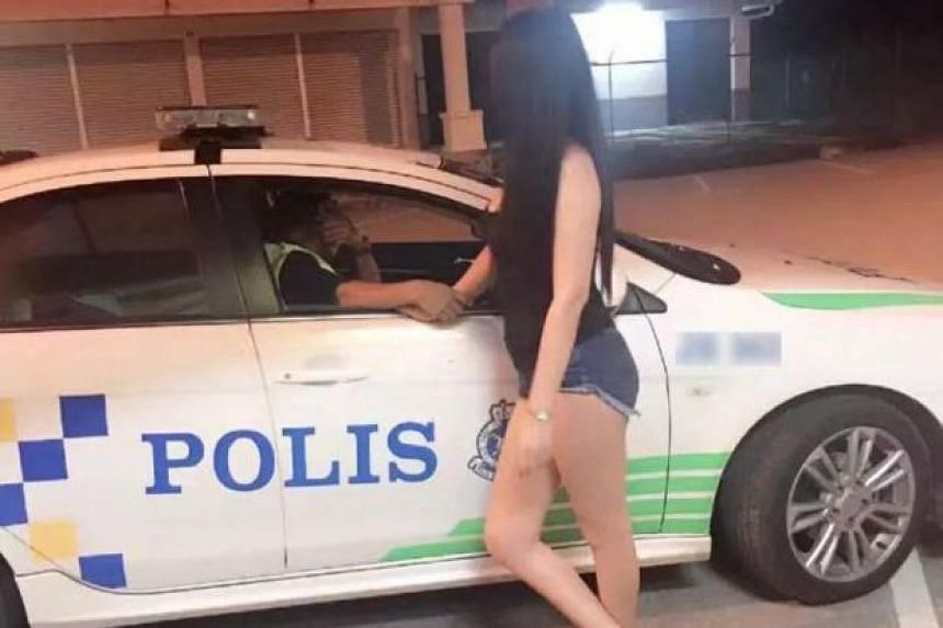 A photo of the policeman talking to the woman, who is believed to be a prostitute, went viral on Facebook.