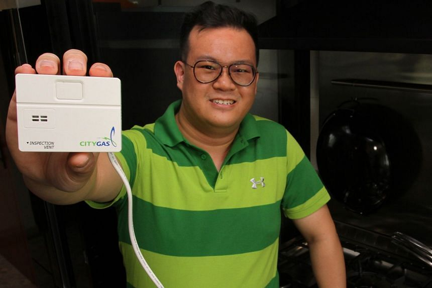 Homeowner Kenneth Lim enjoys better peace of mind with the installation of the new gas detector in his kitchen. The gas detector is developed by City Gas and made in Japan.