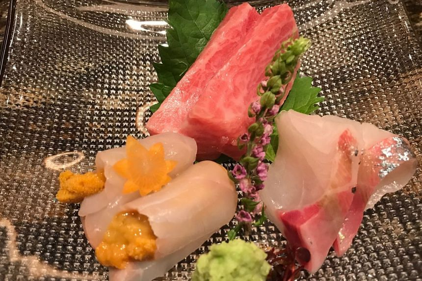 The sashimi is acceptable - two pieces each of toro, amberjack and flounder rolled around a bit of uni.