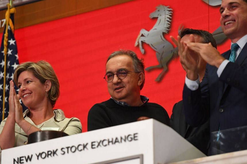 """Ferrari N.V. led by Chairman Sergio Marchionne (centre) and members of the company's leadership team ring the opening bell at the New York Stock Exchange, on Oct 9, 2017. """"The season is not lost, there's still all to do,"""" Marchionne told Italy's Cl"""
