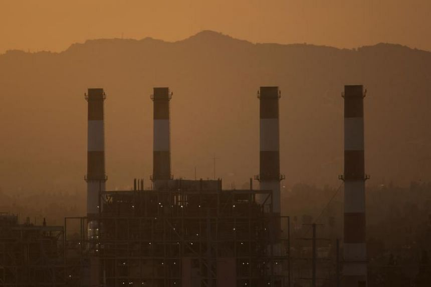 Haze envolops the gas-powered Valley Generating Station in California as carbon dioxide as levels reached a new record high in 2016 and continued to climb in the first two months of 2017.