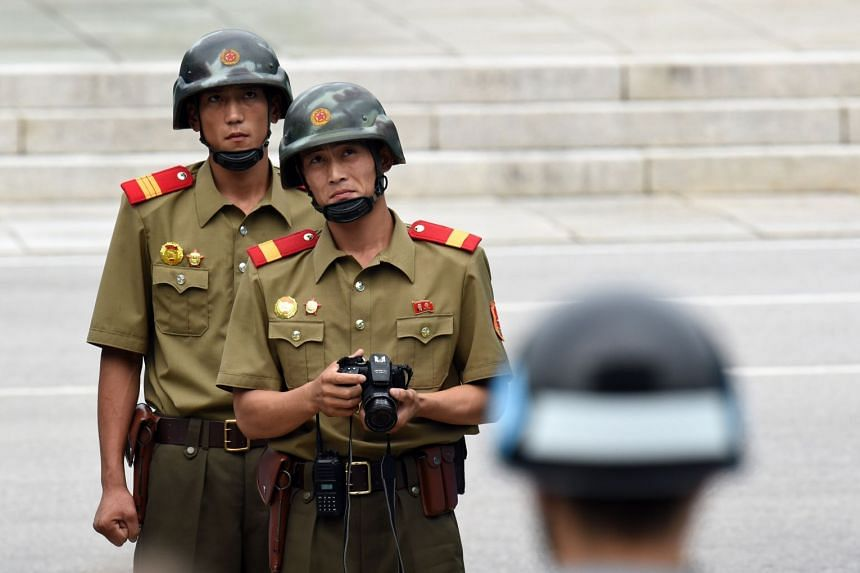 North Korean soldiers watch the South side in the Demilitarised Zone in July, 2017.