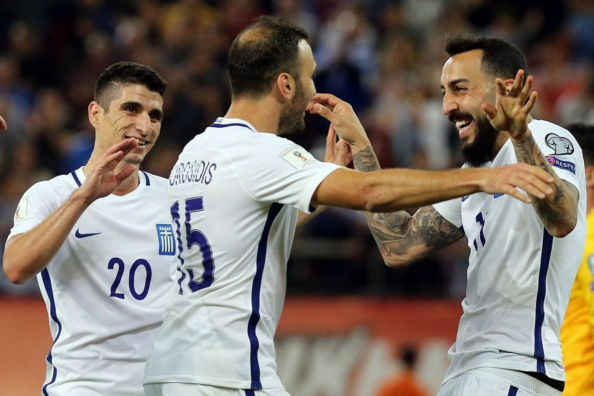 Greece's players celebrate during the match.