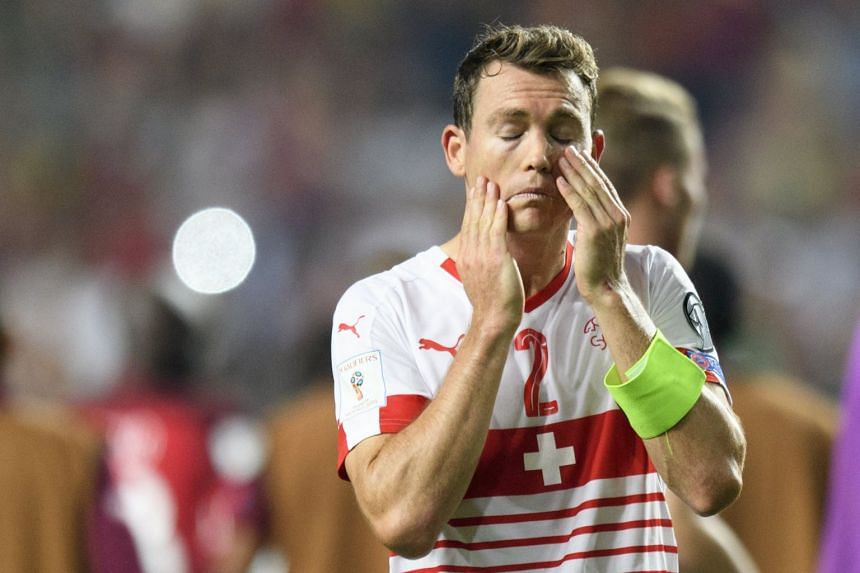 Switzerland defender Stephan Lichtsteiner looks disappointed after losing to Portugal.