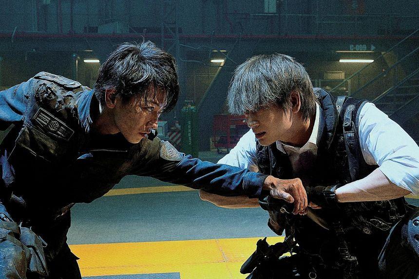 Kei Nagai (Takeru Satoh, left) faces off with his fellow Ajin, Sato (Go Ayano), in Ajin: Demi-Human.