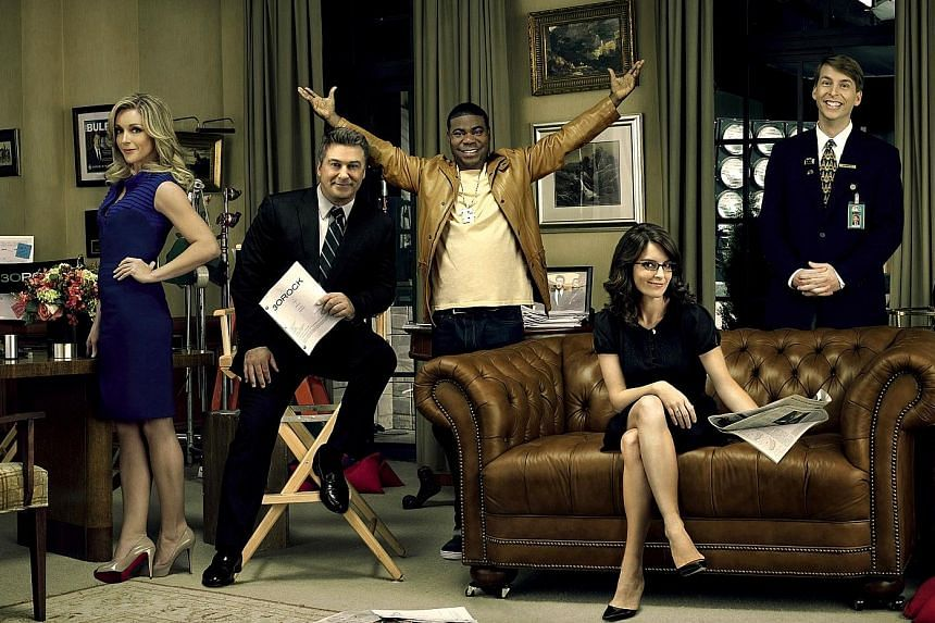 30 Rock, which stars (from far left) Jane Krakowski, Alec Baldwin, Tracy Morgan, Tina Fey and Jack McBrayer, is an NBC series that ran for seven seasons. It used to be on Netflix, but has been acquired by Hulu.