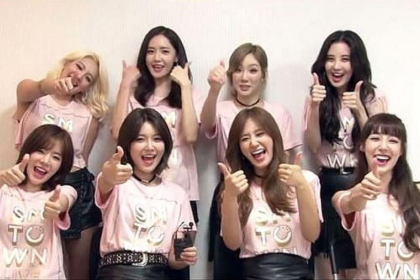Girls' Generation members (back row from left) Hyoyeon, Yoona, Taeyeon, Seohyun and (front row, from left) Sunny, Sooyoung, Yuri and Tiffany.
