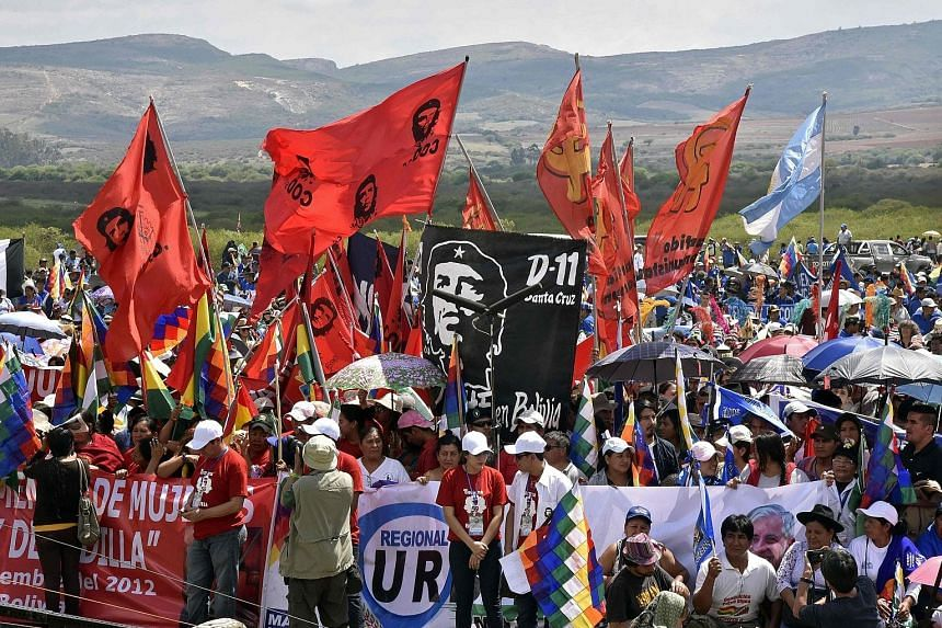 "People commemorating the 50th anniversary of Argentine-born guerilla leader Ernesto ""Che"" Guevara's death at a ceremony in Vallegrande municipality, southern Bolivia, on Monday. The 39-year-old Guevara was captured and executed by a CIA-trained unit"