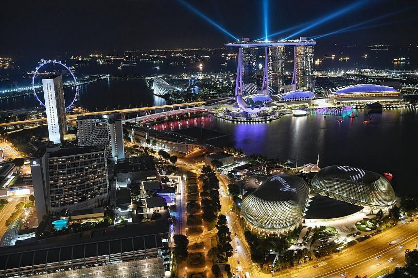 "Esplanade - Theatres on the Bay celebrates its 15th anniversary with big bold lights. From tomorrow to Oct 31, the number ""15"" will shine brightly from the domes nightly, accompanied by a moving-light display. There will be 12 moving-light displays t"