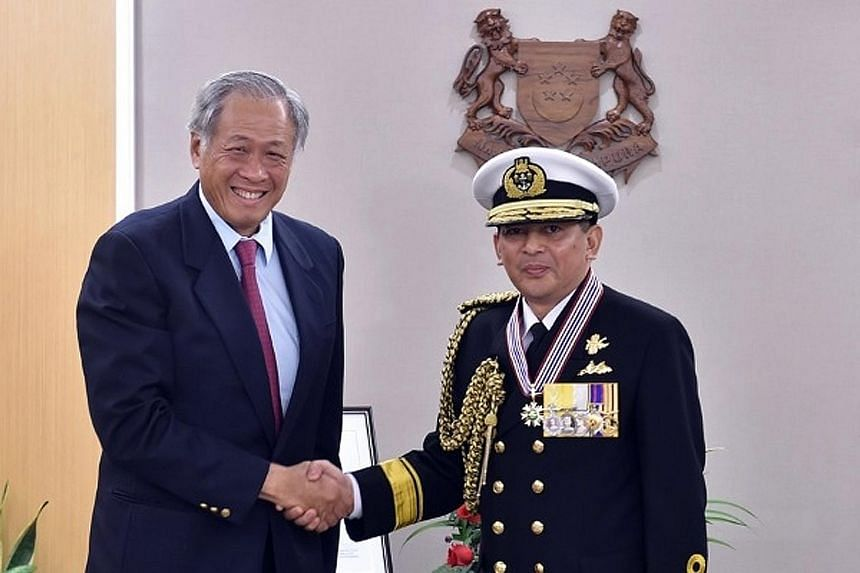 Defence Minister Ng Eng Hen with First-Admiral Norazmi Pengiran Haji Muhammad, who was conferred Singapore's Pingat Jasa Gemilang (Tentera), or Meritorious Service Medal (Military), for enhancing the defence relationship between the Brunei and Singap