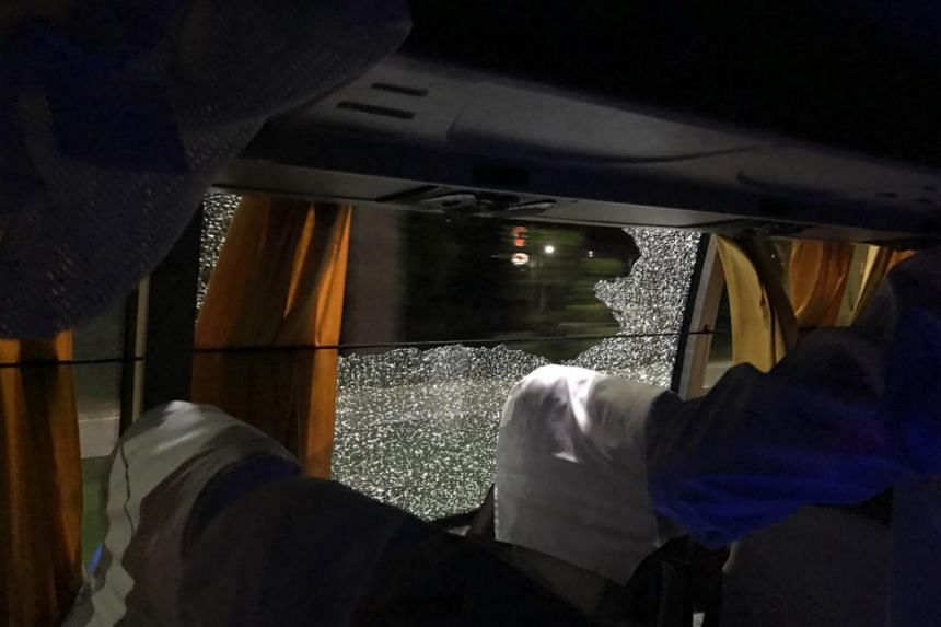 Players and staff were travelling from Busapara Stadium back to their team hotel in the eastern city when the rock pierced the window on the right-hand side of the bus, Cricket Australia said on its website.