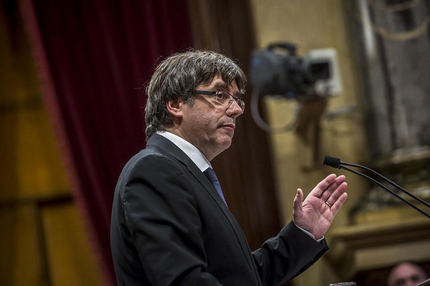 Carles Puigdemont, Catalonia's president, delivers a speech at the Catalan parliament in Barcelona.